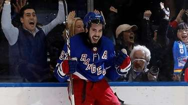 Mika Zibanejad #93 of the Rangers celebrates his