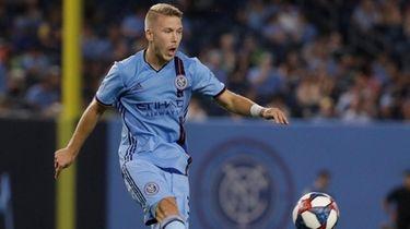 New York City FC's Anton Tinnerholm passes the