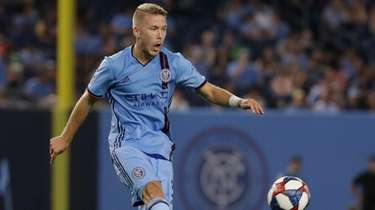 New York City FC's Anton Tinnerholm passes the