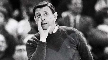 St. John's coach Lou Carnesecca cheers on his