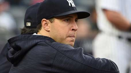 Yankees first baseman Mark Teixeira looks on from
