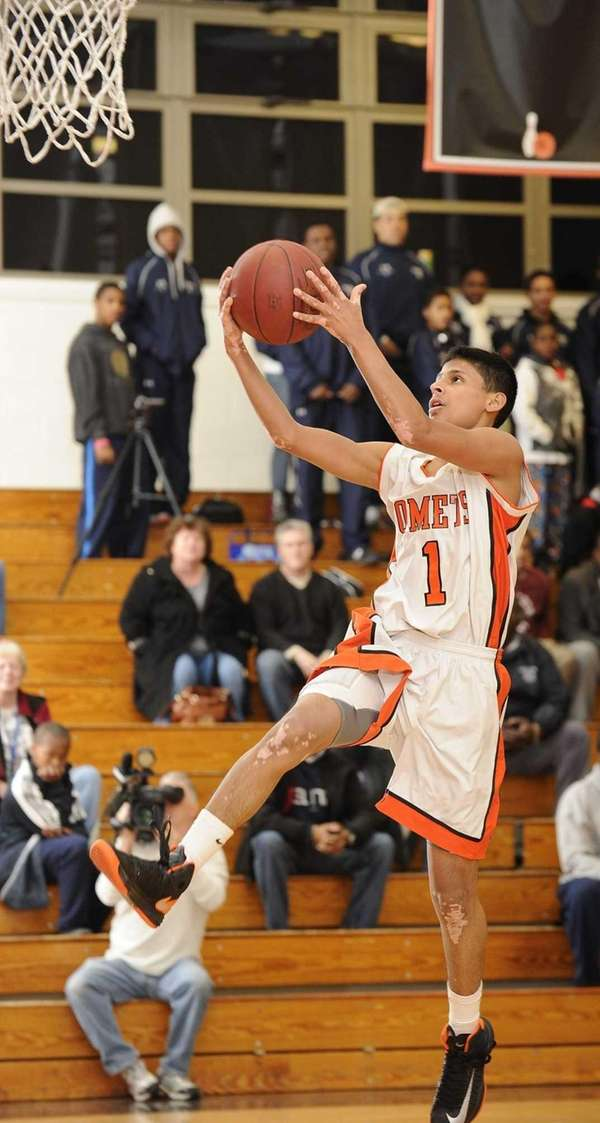 Hicksville's Michal Julka scores on a breakaway layup