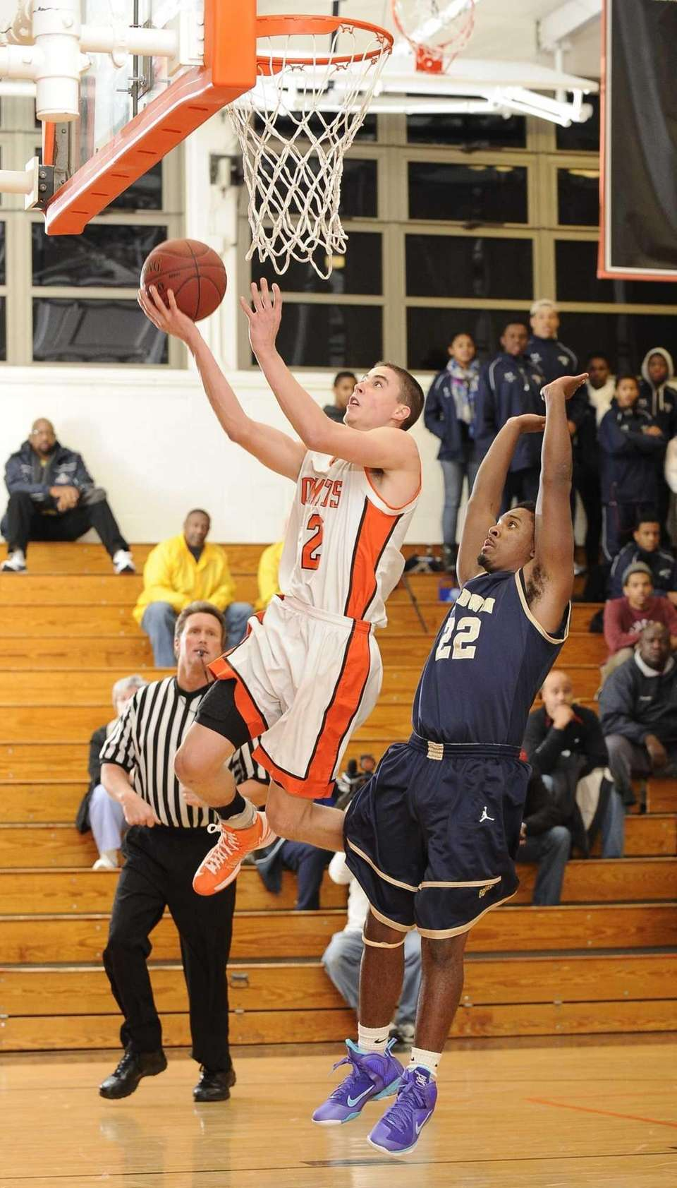 Hicksville's Nick Ptrucelli shoots a layup while Baldwin's