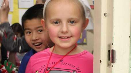 Wearing her pajamas and snowman antlers, 8-year-old Madelynn