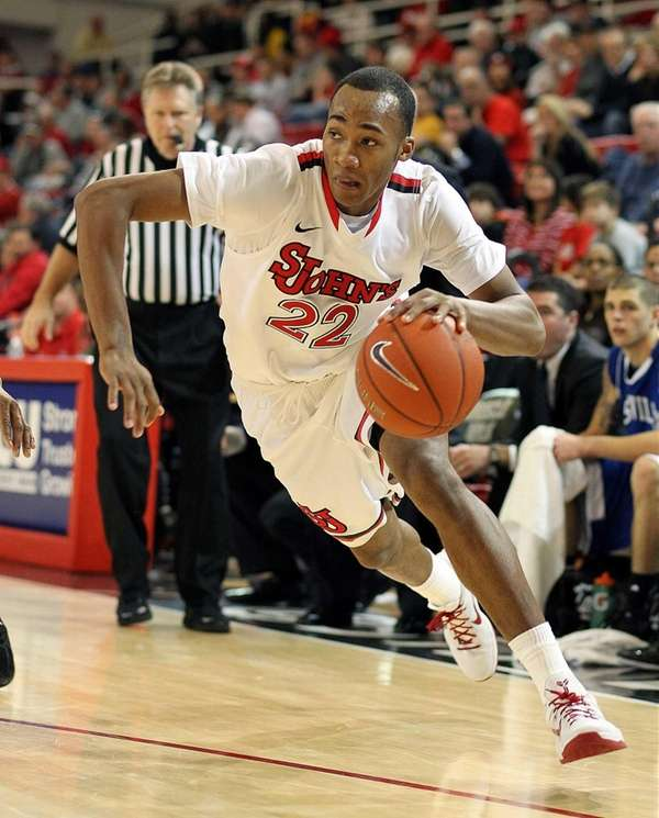 St. John's Amir Garrett drives to the basket