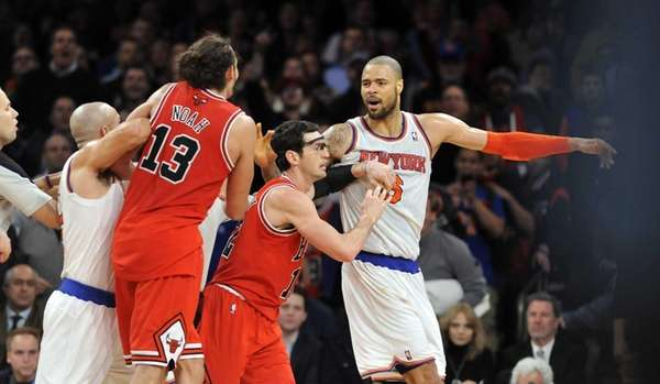 Jason Kidd restrains Chicago Bulls center Joakim Noah