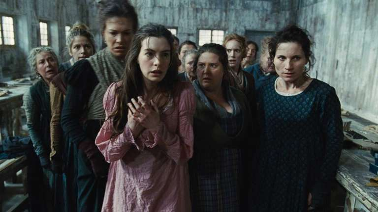 Anne Hathaway, as Fantine, being thrown out of