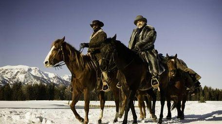 Jamie Foxx, left, as Django and Christoph Waltz