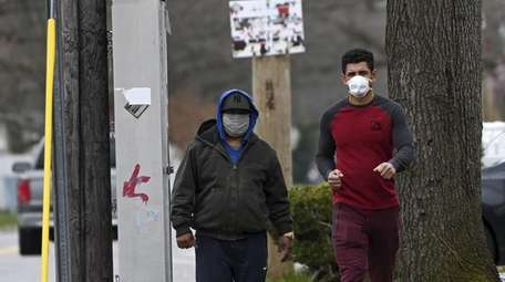 Two men wearing masks in Brentwood on April