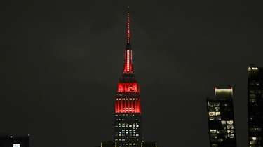 The Empire State building is lit in red
