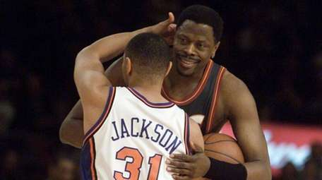 The Knicks' Mark Jackson hugs Patrick Ewing before