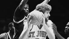 St. John's Bill Wennington holds the ball while