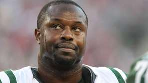 Bart Scott looks on during a game with