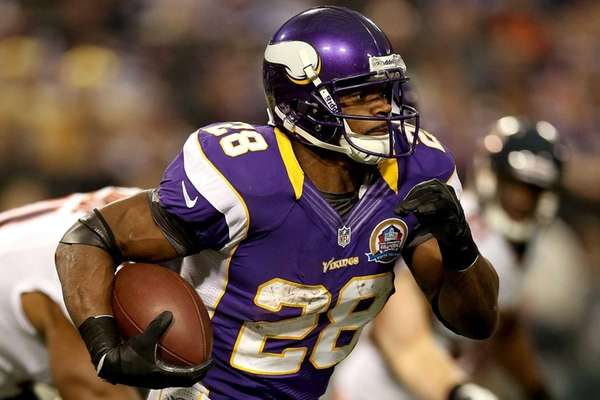 Minnesota Vikings running back Adrian Peterson carries the