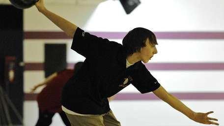 East Islip's Jacob Klein bowls in the Suffolk