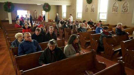 People sit one last time inside Sacred Heart