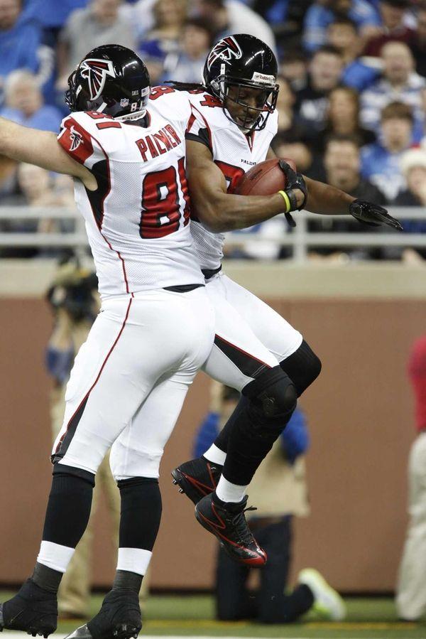 Atlanta Falcons wide receiver Roddy White, right, celebrates