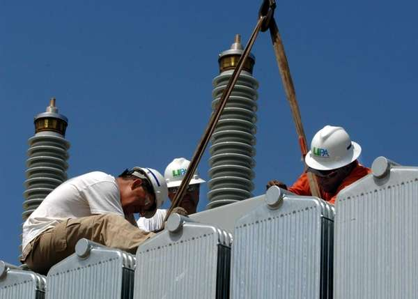 LIPA technicians work on one of two transformers