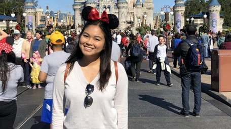 Jeanie Uy, 21, a biology major at Suffolk