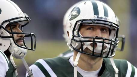 Jets quarterbacks Mark Sanchez, left, and Tim Tebow