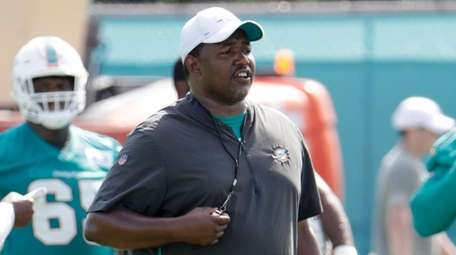 Then-Dolphins defensive coordinator Patrick Graham watches players during