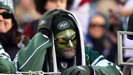 A Jets fans looks on in the fourth