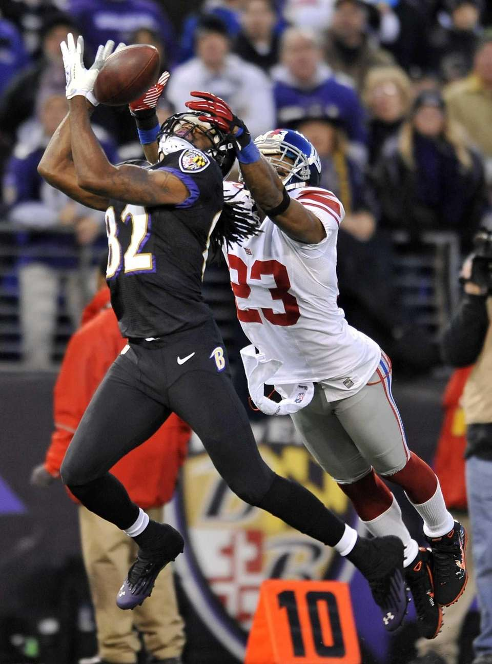 Baltimore Ravens wide receiver Torrey Smith, left, completes
