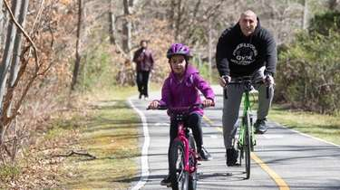 Bikers are seen at Bethpage bikeway in Bethpage
