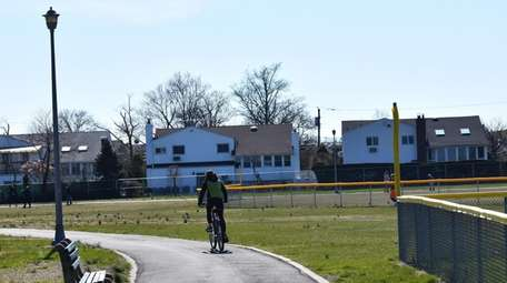 A cyclist rides the short trail that rolls