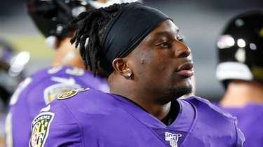 Ravens linebacker Patrick Onwuasor watches from the sideline