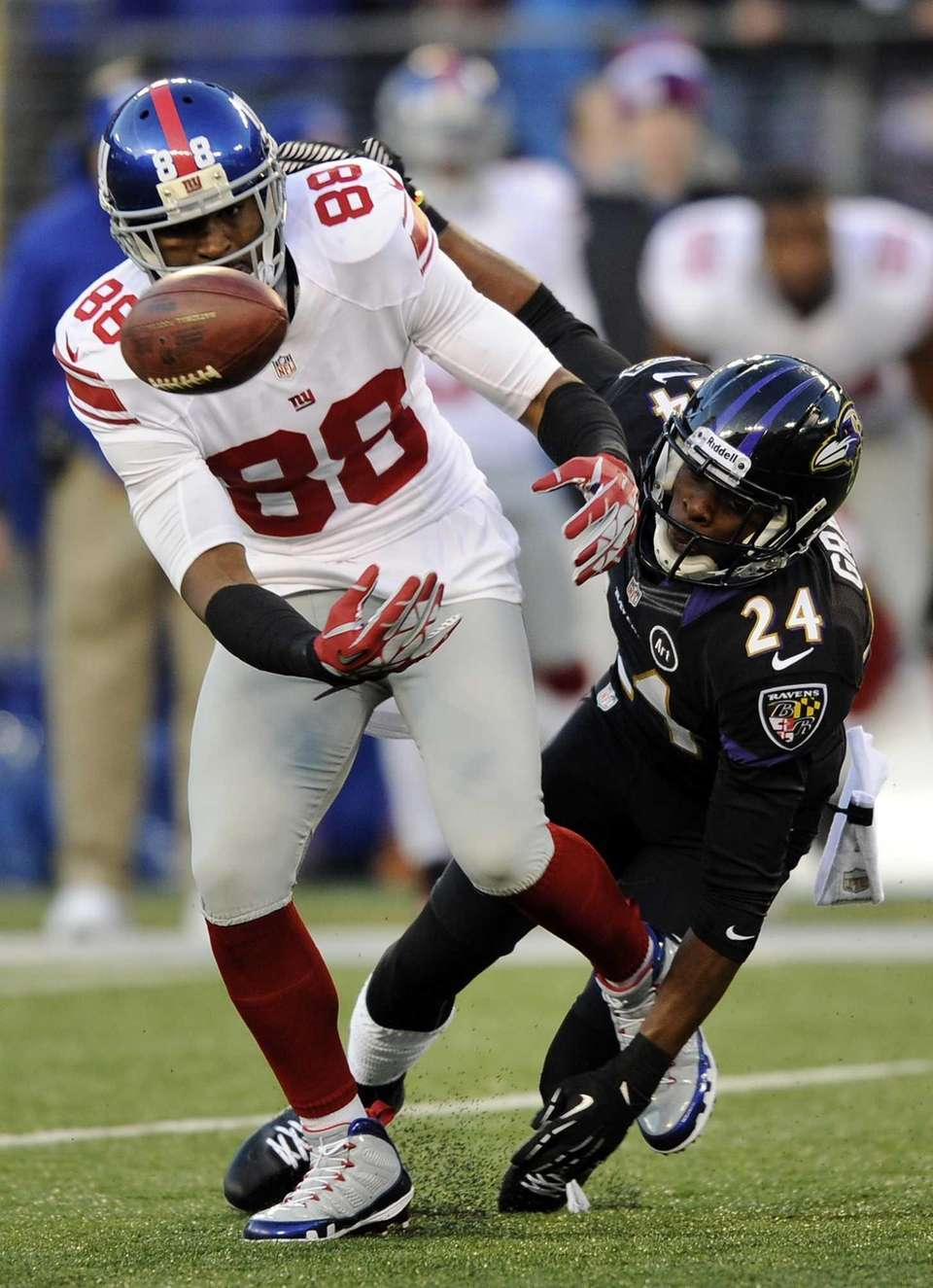 Baltimore Ravens cornerback Corey Graham, back, breaks up