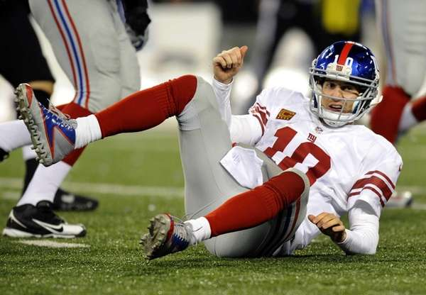 Eli Manning gets up after being tackled by