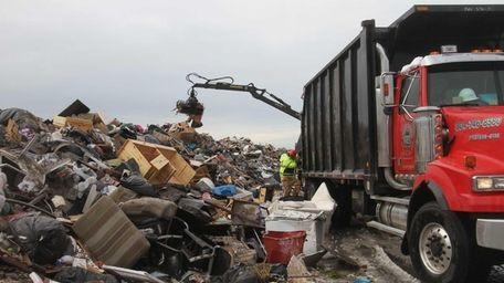 Crews remove families' belongings ruined during superstorm Sandy