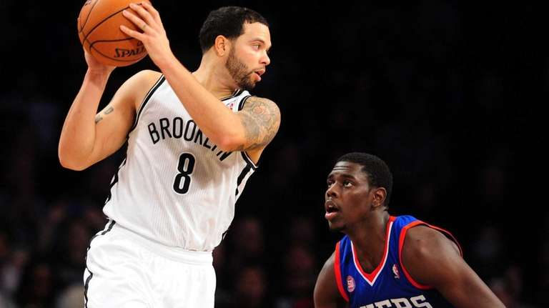 Deron Williams of the Brooklyn Nets is guarded