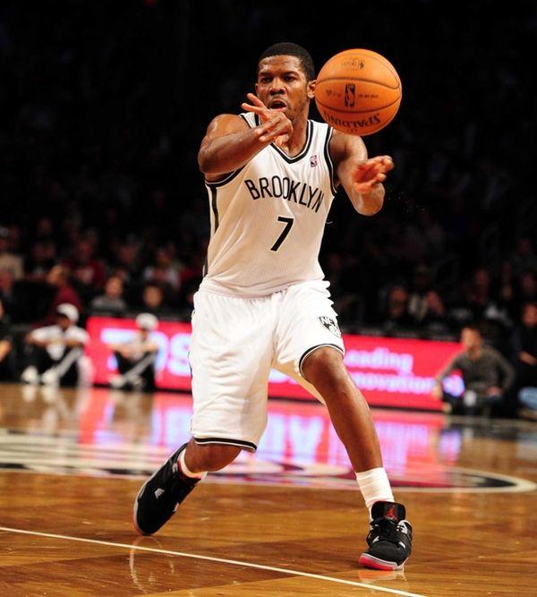 Joe Johnson of the Brooklyn Nets passes the