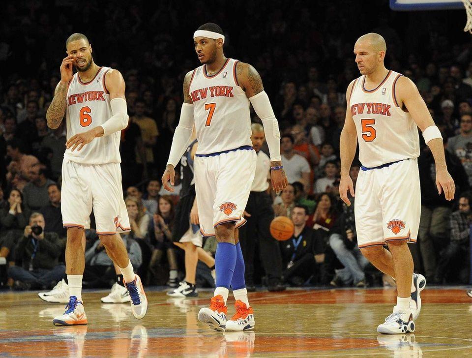 Tyson Chandler, Carmelo Anthony and Jason Kidd walk