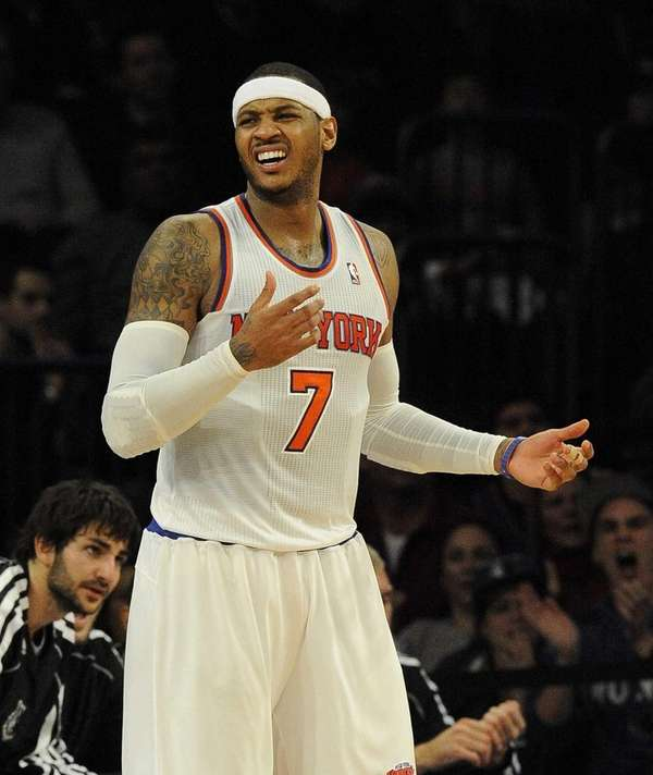 Carmelo Anthony reacts after being called for an