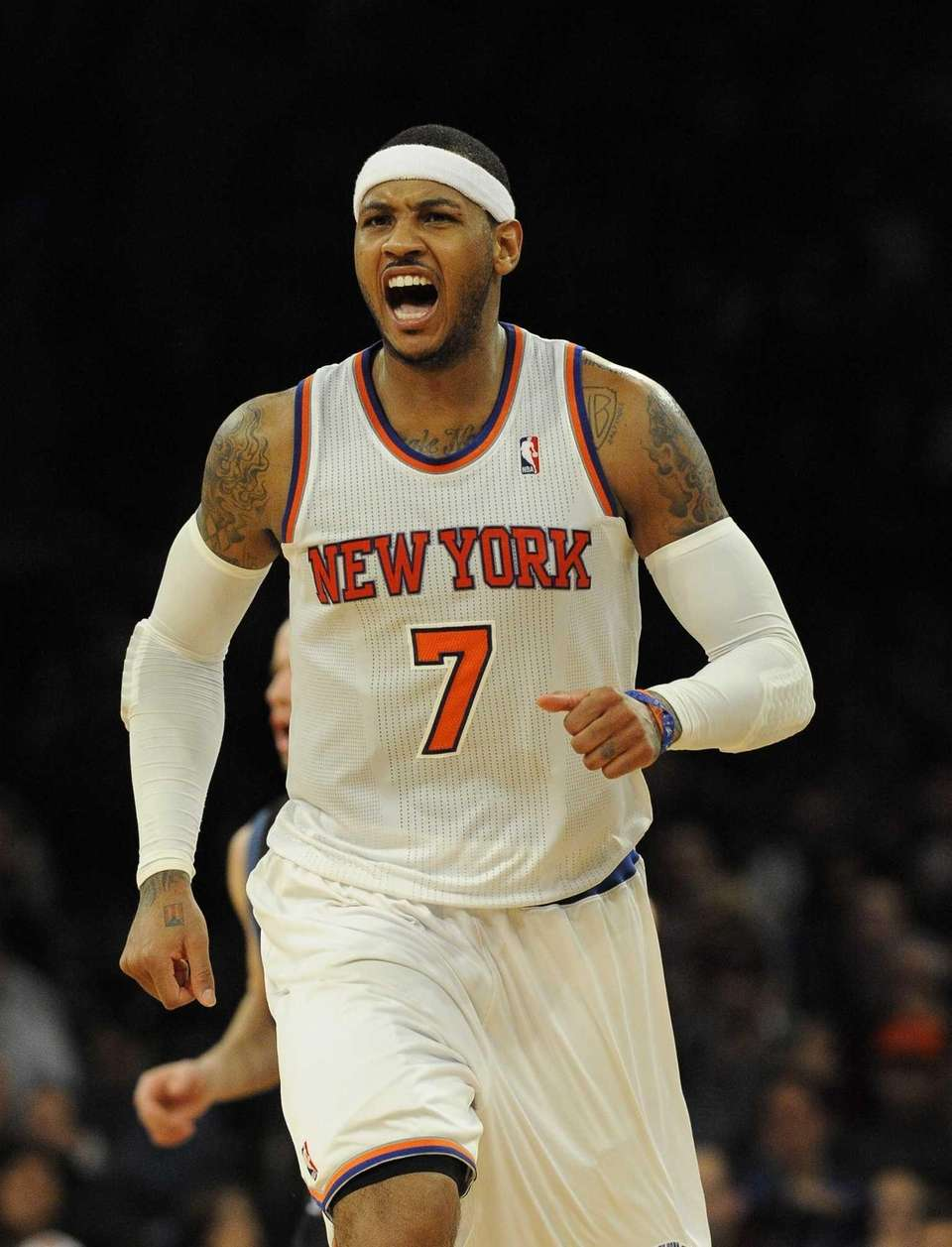 Carmelo Anthony reacts after scoring against the Minnesota