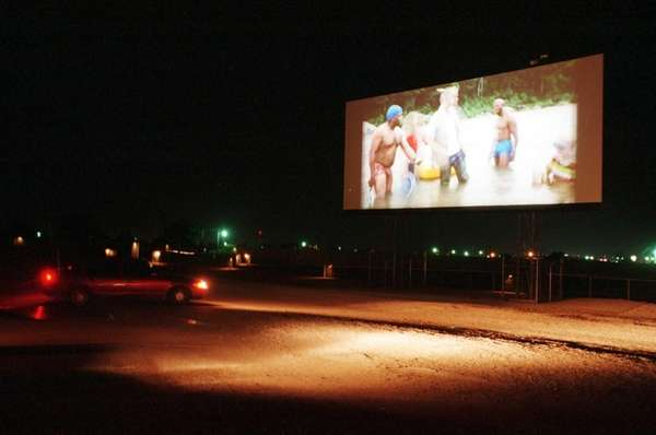 375759 02: Moviegoers enjoy the Fiesta drive-in movie