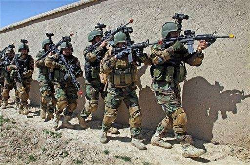 Afghan special forces demonstrate a raid for rescuing