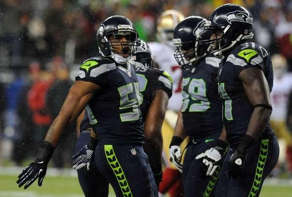 Middle linebacker Bobby Wagner, left, of the Seattle