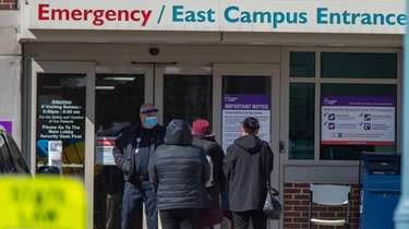 A line forms outside NYU Winthrop University emergency