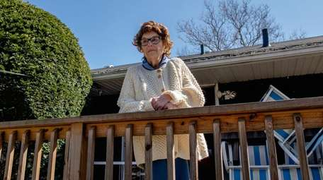 Dorothy Rothstein of Merrick, outside of her home,