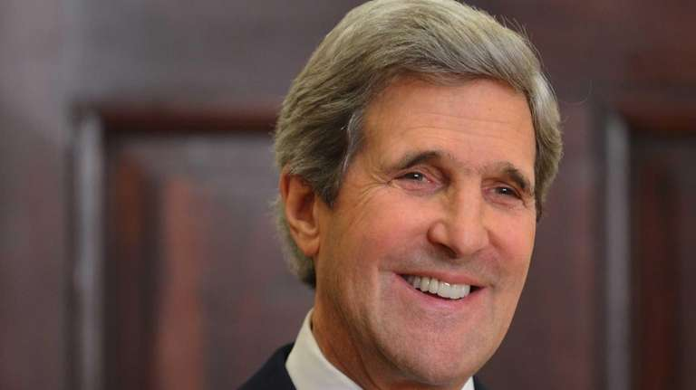 Senator John Kerry smiles as US President Barack