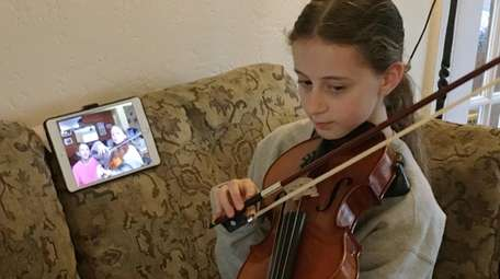 Kelsey Langbart, 12, of Lido Beach, practices music
