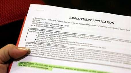 Carmen Nazario of Albany fills out an employment