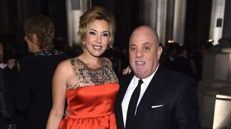 Billy Joel and his wife, Alexis, attend the