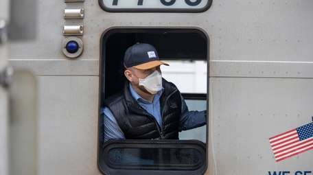 An LIRR conductor at the LIRR station in