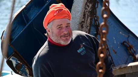 Commercial fisherman Chuck Morici on his trawler in