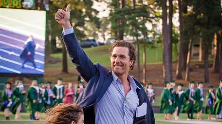 Alumnus Matthew McConaughey takes the field with two